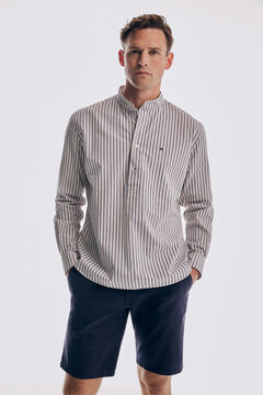 Set of striped polo shirt and seersucker bermuda shorts